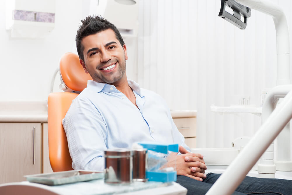 Happy patient with white teeth